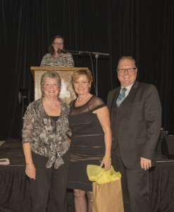 Our Sponsor Christine and Terry Vos receive their gift from President, Libbie Burns