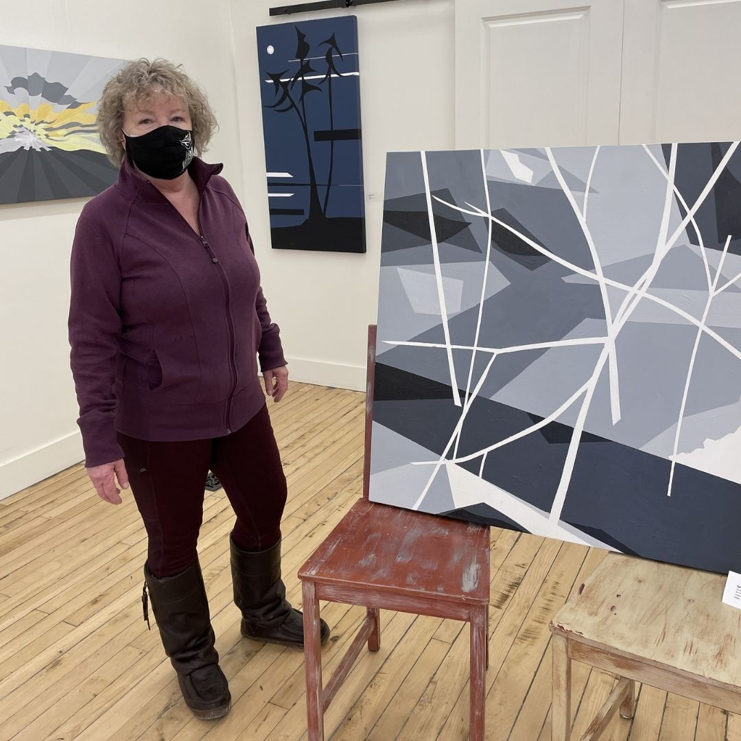 Leslie Beauchamp poses with one of her pieces.